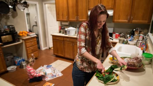 Maggie Barcellano prepares dinner at her father's house in Austin, Texas. Working-age people now make up the majority in U.S. households that rely on food stamps, a switch from a few years ago when children and the elderly were the main recipients.