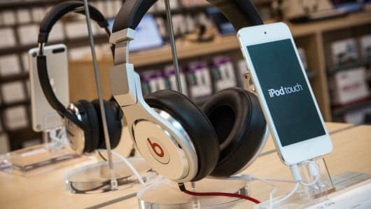 Beats headphones are sold along side iPods in an Apple store.
