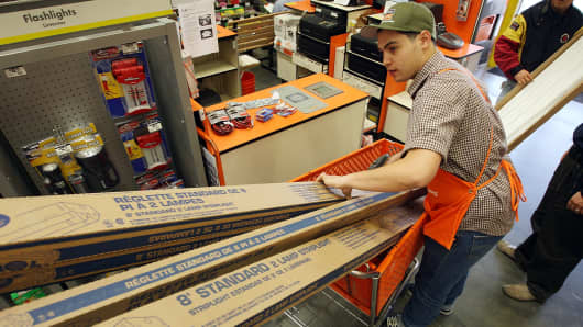 Customers buy goods at a Home Depot home improvement store.