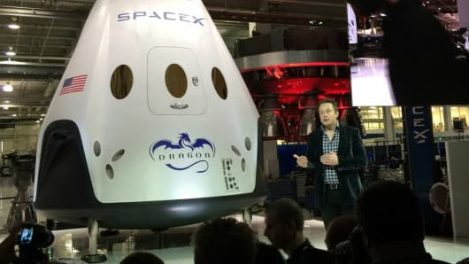 Elon Musk at an event to showcase SpaceX's Dragon V2 capsule.
