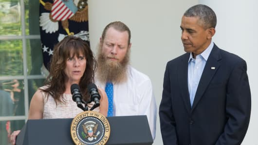 Jani Bergdahl makes a statement about the release of her son Sgt. Bowe Bergdahl as her husband Bob Bergdahl and President Barack Obama listen.