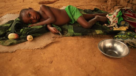 File photo: A malaria victim rests at a small medical center in the Democratic Republic of Congo.