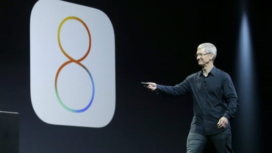 Apple CEO Tim Cook speaks about iOS 8 at the Apple Worldwide Developers Conference in San Francisco.