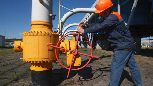 An employee tightens the valve on a pipeline at the Bilche-Volytsko-Uherske underground gas storage facility, the largest in Europe,  in the Lviv region of western Ukraine.