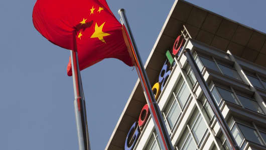 A Chinese flag flys outside the Google Inc. China headquarters in Beijing, China.