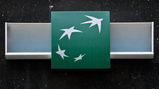 The logo of BNP Paribas sits outside a branch of the bank in Paris, France.