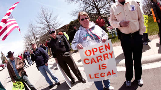 Supporters of Michigan's Open Carry law attend a rally April 27, 2014 in Romulus, Michigan.