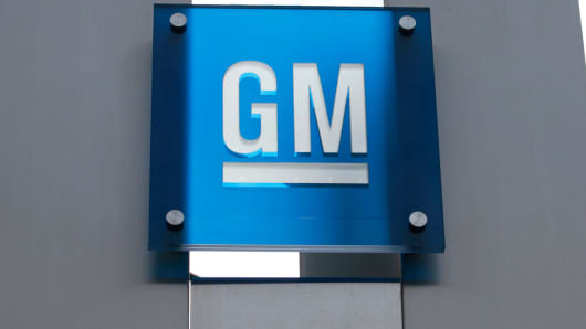 The General Motors logo is seen at their world headquarters in Detroit.