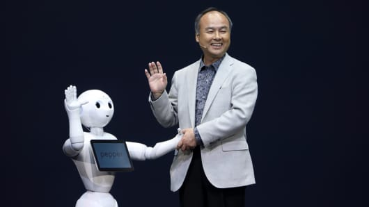 SoftBank's Masayoshi Son with the Pepper human-like robot.