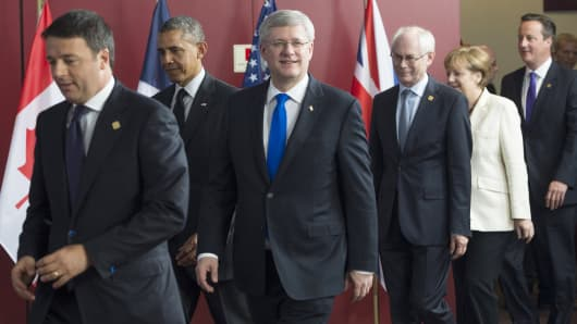 (From L-R) Italian President Matteo Renzi, US President Barack Obama, Canadian Prime Minister Stephen Harper, President of the European Council Herman Van Rompuy, German Chancellor Angela Merkel and British Prime Minister David Cameron arrive for a group photograph during the G7 Summit at the European Council in Brussels, Belgium.
