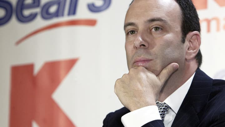 In this Nov. 17, 2004 file photo, Kmart chairman Edward Lampert listens during a news conference to announce the merger of Kmart and Sears in New York.