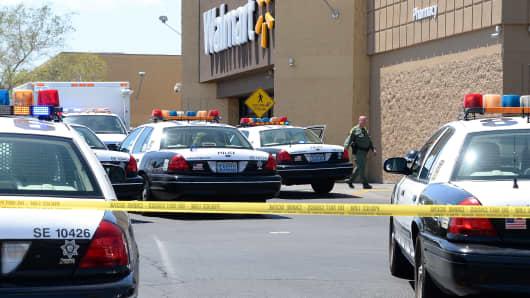 A Las Vegas Metropolitan Police Department officer walks outside a Wal-Mart on June 8, 2014 in Las Vegas, Nevada.