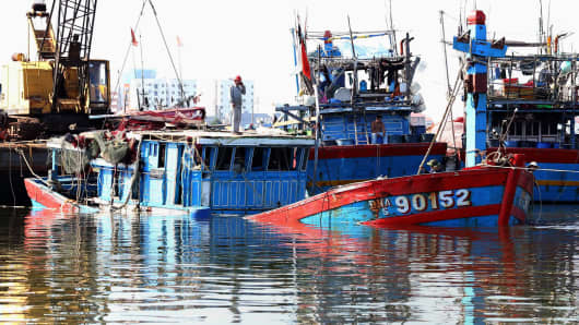 The Vietnamese fishing boat 'DNA 90152' (L), which was reportedly sunk by a Chinese ship, at a shipyard in the central coastal city of Danang.