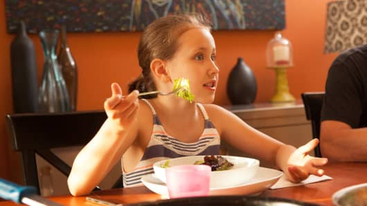 Isabelle Thomelin, 8, having dinner at her home in Seattle, May 15, 2014.