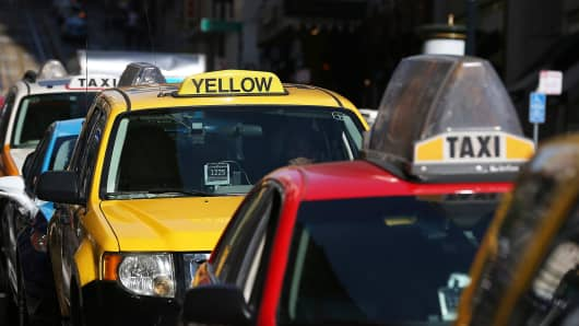 Taxicabs wait for fares in front of the St. Francis Hotel in San Francisco, Calif.