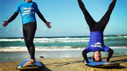 """""""Am I doing this right?"""" Surf lessons on Bondi Beach."""