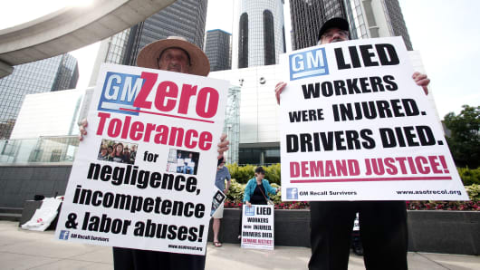 protesters in front of the General Motors world headquarters where the GM 2014 Annual Shareholders meeting is taking place June 10, 2014 in Detroit, Michigan.