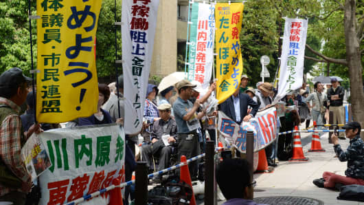 About 50 anti-nuclear demonstrators stage a rally in Tokyo against re-opening the Sendai nuclear power plant operated by Kyushu Electric Power Company.