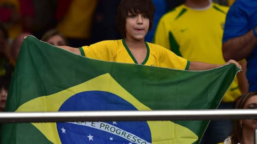 Brazilian fan cheers before the start of a friendly football match against Serbia in preparation for FIFA World Cup Brazil 2014.