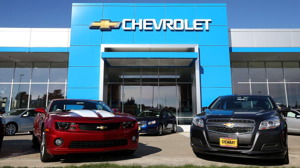 New cars sit on the lot of a Chevrolet dealership in Colma, California.