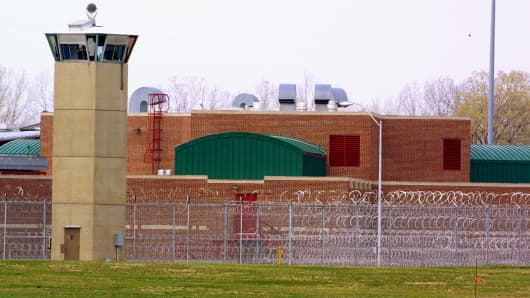 A guard's tower and concertina wire mark the perimeter of the Federal Prison in Terre Haute, Indiana, April 9, 2001.