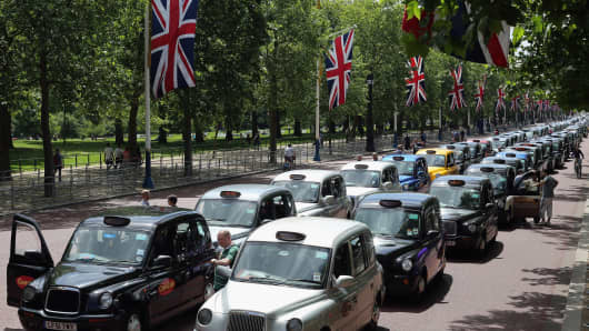 London taxis line up on The Mall during a protest against a new smart phone app, 'Uber' on June 11, 2014 in London, England.