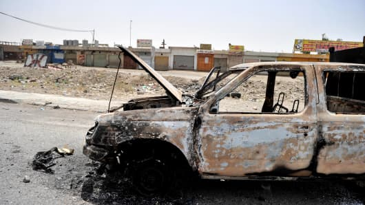 A burned car in Mosul, Iraq.