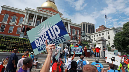 Workers rally in front of Massachusetts State Capitol (File photo)