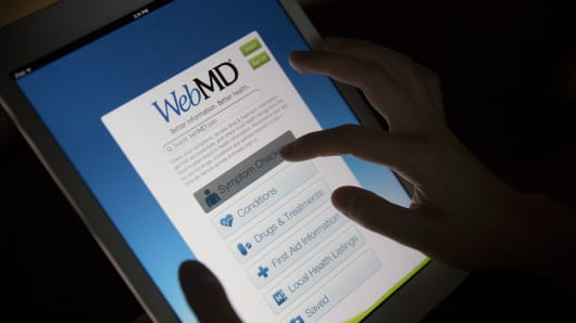 The WebMD application is demonstrated on an Apple Inc. iPad Air.