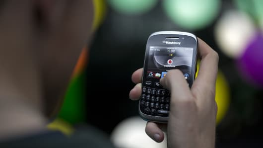 A BlackBerry Curve smartphone, produced by BlackBerry Ltd., is seen in this arranged photograph taken in London, U.K., on Monday, Sept. 23, 2013.