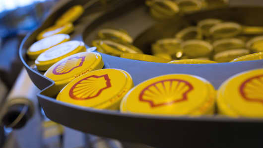 Shell branded Tri-Sure tab-seal barrel caps are sorted ahead of fitting to oil drums at Royal Dutch Shell Plc's lubricants blending plant in Torzhok, Russia.