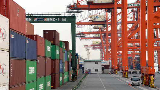 Cargo containers are placed at a container wharf in the port of Tokyo.