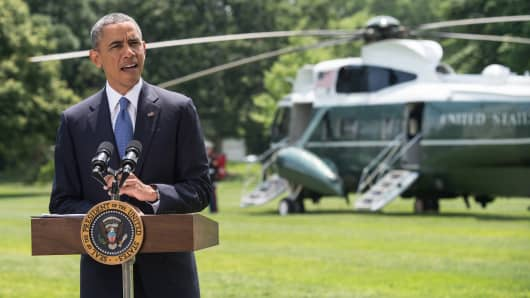 President Barack Obama makes a statement on Iraq on the South Lawn of the White House in Washington on June 13, 2014.