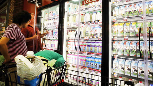 A person shops for milk in a Brooklyn supermarket on June 9, 2014 in New York City. Milk prices for Americans have been on the rise recently with a 7.5 percent price increase for a gallon of fortified whole milk from last year.