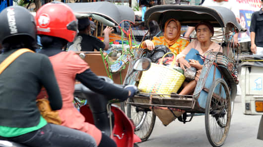 "Two woman in a ""becak"" (cycle rickshaw) in Central Java, Indonesia."