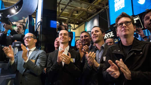Twitter co-founder Biz Stone applauds as Twitter rings the opening bell at the New York Stock Exchange
