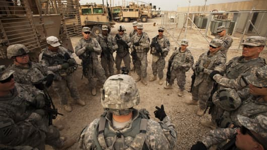 Soldiers from the 3rd Brigade Combat Team, 1st Cavalry Division go over last minute details before going out on the U.S. military's last combat patrol in the country, at Camp Adder on December 16, 2011 near Nasiriyah, Iraq.