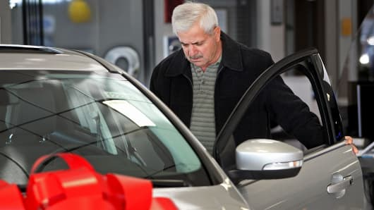 A customer views a Ford Motor Co. Focus vehicle displayed for sale at a dealership in Niles, Illinois.