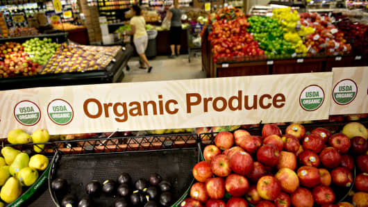 An organic produce sign stands over a display in the produce department of a Kroger supermarket in Peoria, Illinois.