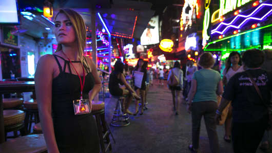 Thai women working at a bar wait for business at the red light district called Soi Cowboy in Bangkok