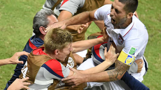 US forward Clint Dempsey celebrates after scoring during a football match between USA and Portugal during the 2014 FIFA World Cup on June 22, 2014.