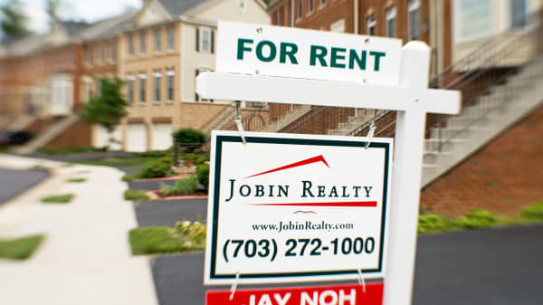 A house for rent sign is viewed on June 4, 2014, in Centreville, Virginia.