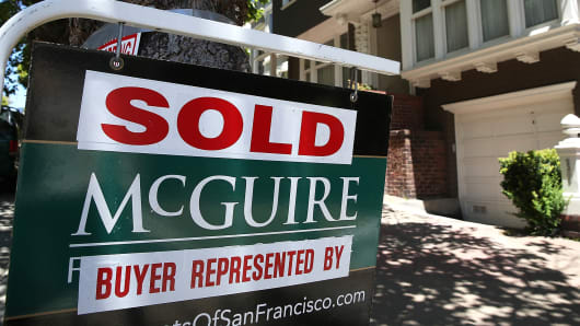 A sold sign is posted in front of a home for sale on May 27, 2014 in San Francisco, Calif.