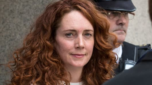 Former News International chief executive Rebekah Brooks and her husband Charlie Brooks leave the Old Bailey on June 24, 2014 in London, England.
