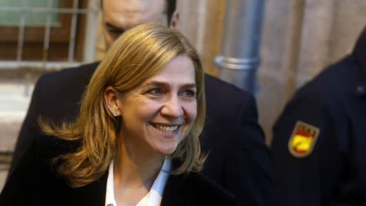 Spain's Cristina de Borbon, sister of the newly-crowned King Felipe VI, leaves a courthouse after testifying in front of judge Jose Castro over tax fraud and money-laundering charges in Palma de Mallorca February 8, 2014.