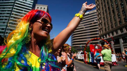 A woman cheers during the Utah Pride Parade in Salt Lake City, Utah, June 8, 2014.