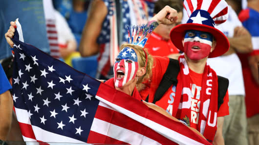 A United States fan cheers while holding an American flag prior to the 2014 FIFA World Cup Brazil Group G match between Ghana and the United States at Estadio das Dunas on June 16, 2014 in Natal, Brazil.