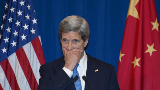 Secretary of State John Kerry listens to questions from US and Chinese media during a press conference in Beijing on April 13, 2013. China and the US, which are embroiled in a bitter dispute over hacking, have agreed to set up a cybersecurity working group, US Secretary of State John Kerry said.