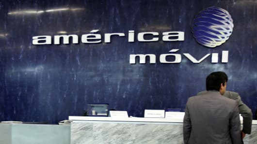 The logo of America Movil is seen on the wall of the reception area in the company's corporate offices in Mexico City.