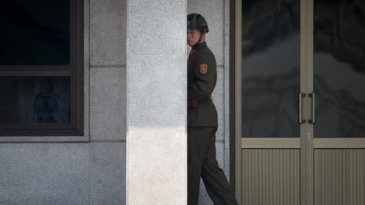 A North Korean soldier walks along his side of the truce village of Panmunjom in the Demilitarized Zone (DMZ) between North and South Korea.